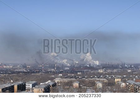 Pollution of the atmosphere by harmful emissions from industrial production.