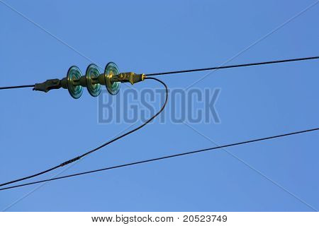 Power lines with sky as background