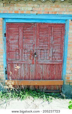 old wooden door in a brick building