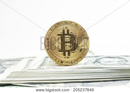 bitcoin coin on us dollars close up