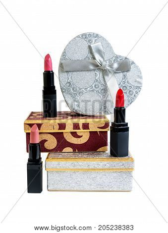 Gift boxes and lipsticks isolated on white background