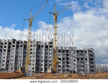 Crane Construction Site. Tower crane on industrial building construction.