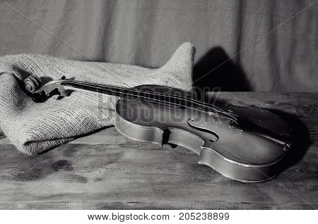 old violin lying on a wooden table
