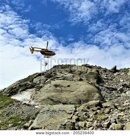 Helicopter rescue from Lac Blanc trail, looking up from bottom of steep rocky grade.