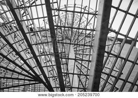 Metallic fire escape metallic spiral staircase shot straight up.