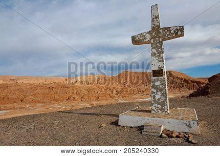 SAN PEDRO DE ATACAMA, CHILE - OCTOBER 24, 2013: Cross in the Atacama desert in memory of the pope Juan Pablo the Second visit near San Pedro de Atacama, Chile.