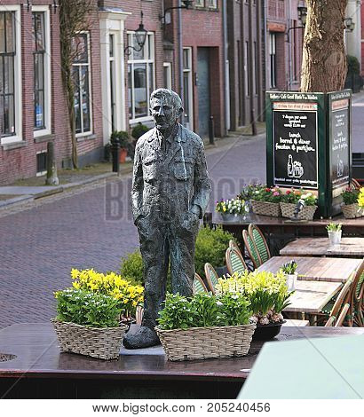 MUIDEN, NETHERLANDS - April 8, 2016: Small street sculpture of a man in Muiden, Netherlands.