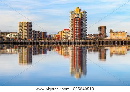 Riverside Apartment Next To Thames Barrier With Its Reflection From River Thames