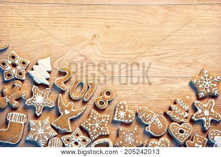 Christmas background with Gingerbread cookies on wooden table. Copy space for your text. Top view. High resolution product