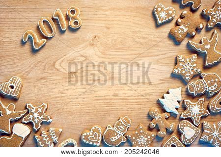 Merry Christmas and Happy new year! Traditional Christmas cookies on wooden table. Copy space for your text. Top view. High resolution product. Christmas baking concept