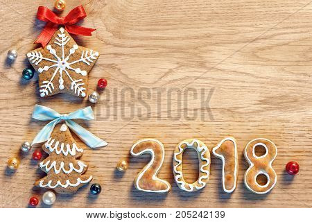Gingerbread cookies on wooden table. Merry Christmas and Happy New Year 2018! Copy space for your text. Close up top view. High resolution product