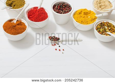 the spices on the white wooden background