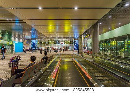 Visitors Walk Around Departure Hall In Changi Airport Singapore
