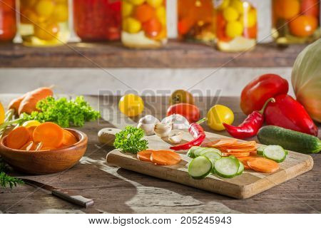 the canned and fresh vegetables in jars