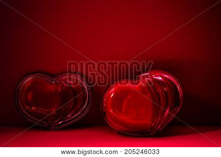 Red heart made of glass on a beautiful table. World Health Day and the concept of health.