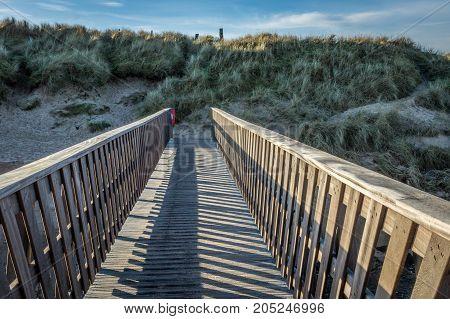 A footbridge crosses a small stream in Cruden Bay.