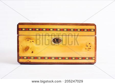 yellow wooden jewelry box casket isolated on white background