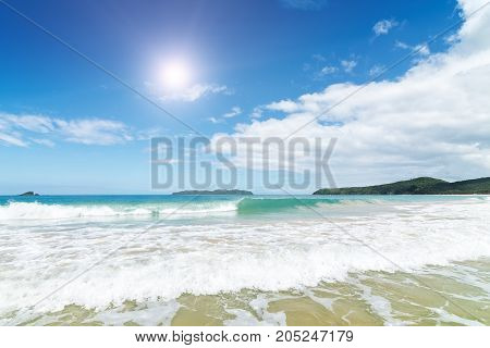 Waves In The Sea And Sand On The Beach.