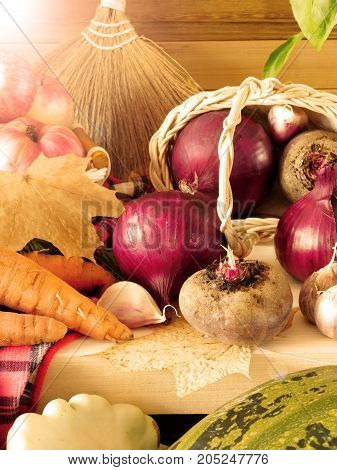 Freshly picked harvest of different autumn vegetables and fruit on a wooden background. Autumn harvest. Photo with special editing