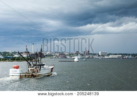 New Bedford Massachusetts USA - June 22 2007: Fishing vessel beating summer storm to New Bedford harbor