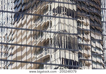 The building reflection off the glass covered skyscraper in Vancouver downtown (British Columbia).