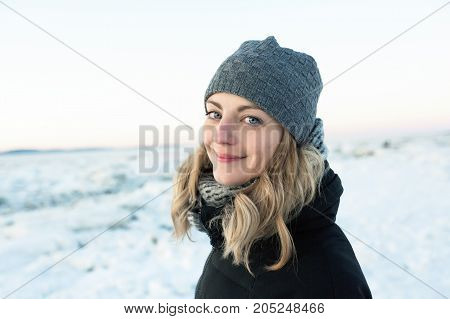 A portrait of a young woman in winter season beach