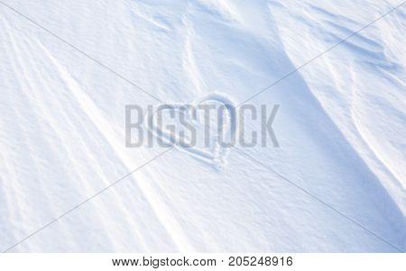 A Heart in winter season write on the snow
