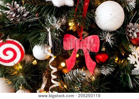 Decorated Christmas tree on blurred sparkling and fairy background