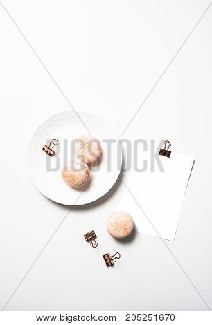 Social media flat lay with orange macaroons and postcard mock up on white table background