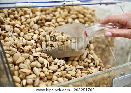 Buyer Takes Pistachio Nuts In Store