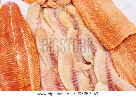 Cooled Fish Fillet Of Tilapia And Salmon On Store