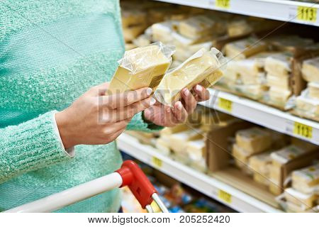 Buyer Chooses Cheese In Store
