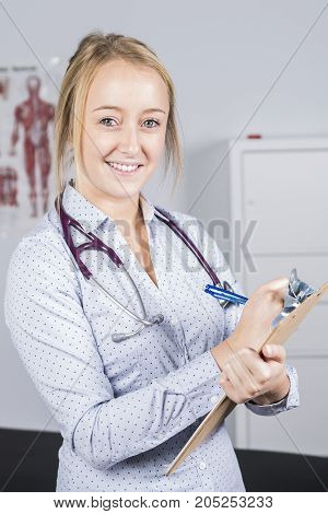 A Portrait of smiling doctor looking at camera in medical office