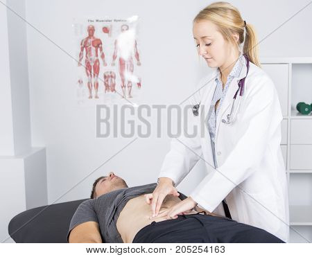 A Doctor examining her patient in medical office