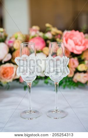 table serving with glasses and flowers for wedding