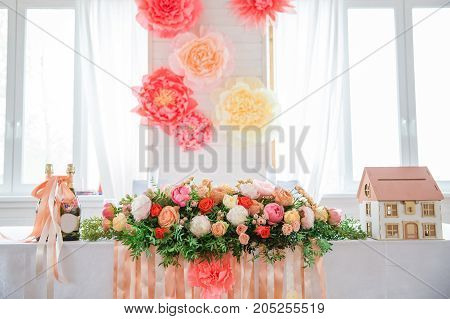 flowers on the table in bright hall near window