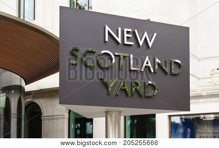 LONDON, UK - AUGUST 16, 2017 : View of the rotating sign outside New Scotland Yard on August 16, 2017 in London, UK. New Scotland Yard has been the headquarters of London's Metropolitan Police since 1967.