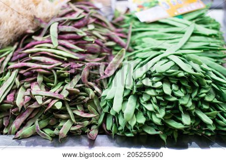Green beans in the market. Background. Healthy food.