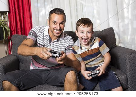 A father and son playing in the living room