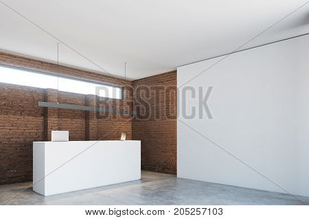 Brick Wall Office, White Reception Desk Side