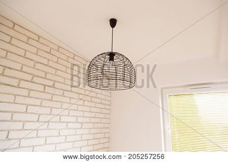 Suspended chandelier in loft style in a modern house interior
