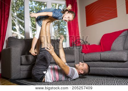 Father and daughter playing in the living room
