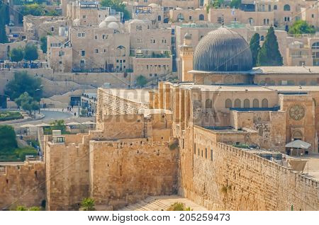 JERUSALEM, ISRAEL. September 15, 2017. A view of the Al Aqsa mosque (gray dome) and the external walls of the Old city of Jerusalem. The mosque is considered the third holiest place in Islam.