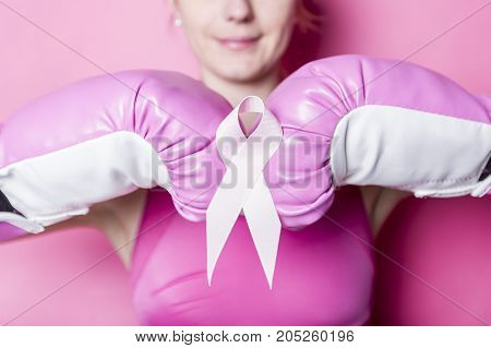 A Fight for Breast Cancer woman with symbol on pink background