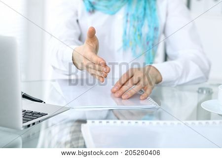 Business woman with hand out for handshake. Close-up of an open hand.