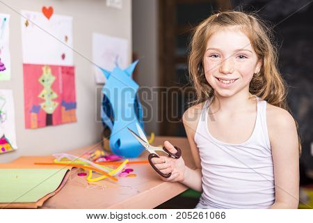 A Young Girl use his imagination with cardboard