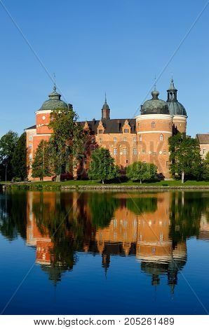 The Swedish 16th-century Gripsholm Castle loacted in Mariefred with its reflection in the water.