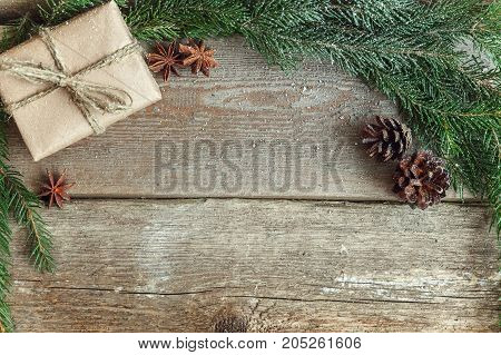 Christmas background with decorations on wooden board and place for text. Flat lay. Christmas concept. Copy space