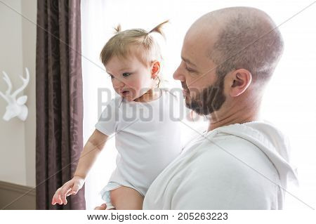 A family father playing with toddler baby