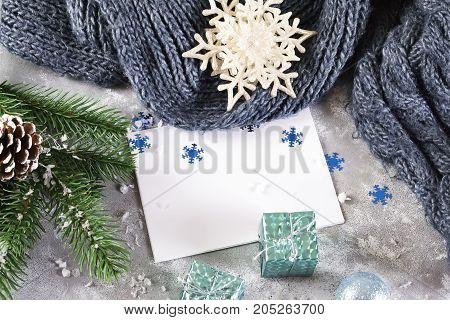 christmas greeting card with christmas decorated with cones green branches fir trees on gray concrete background copy space.new year